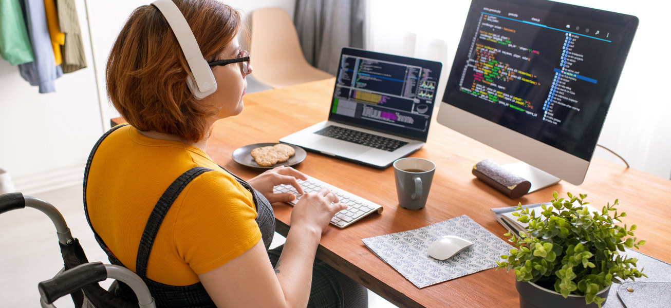 coding-woman-wheelchair-workspace-computer