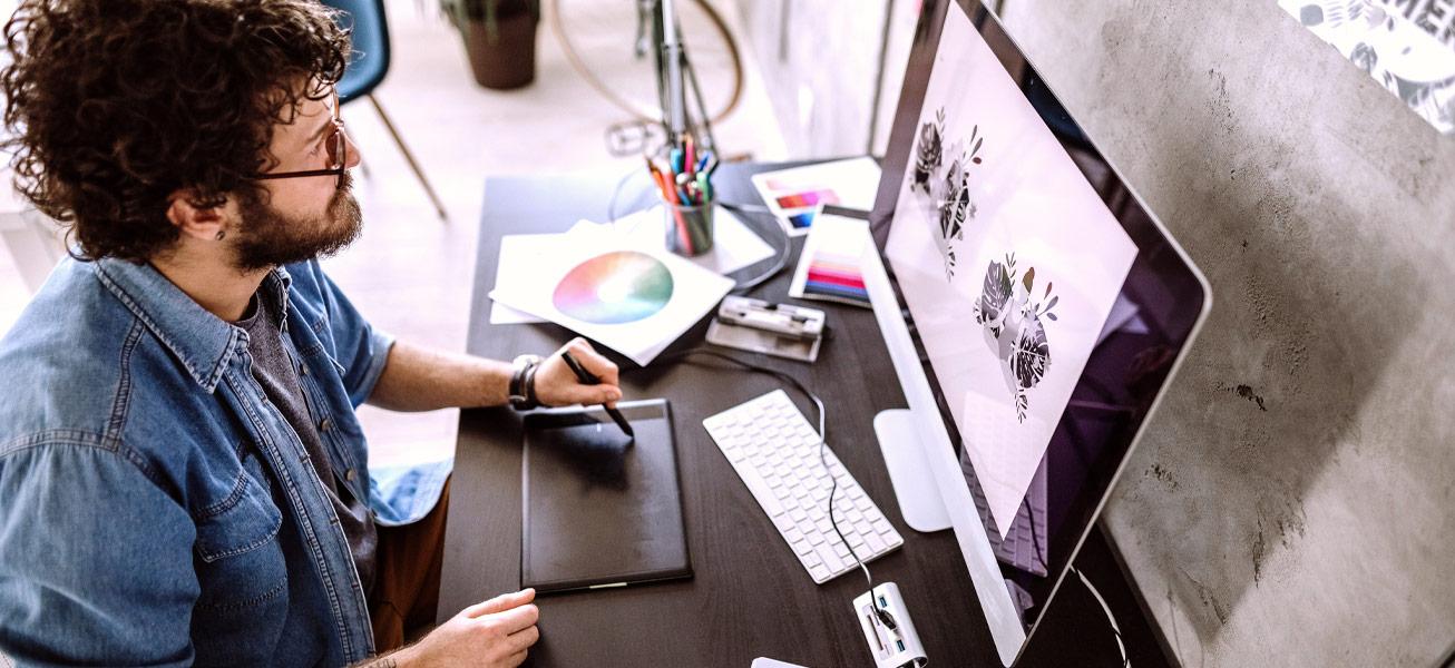 man-graphic-designer-illustrator-working-computer
